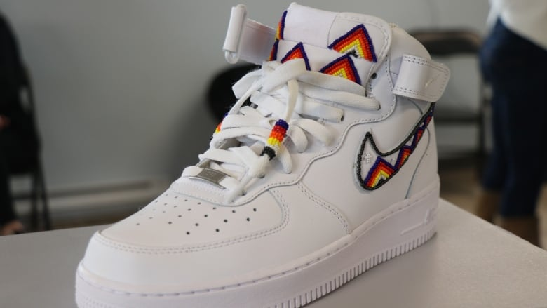A beaded Air Force One high-top sneaker